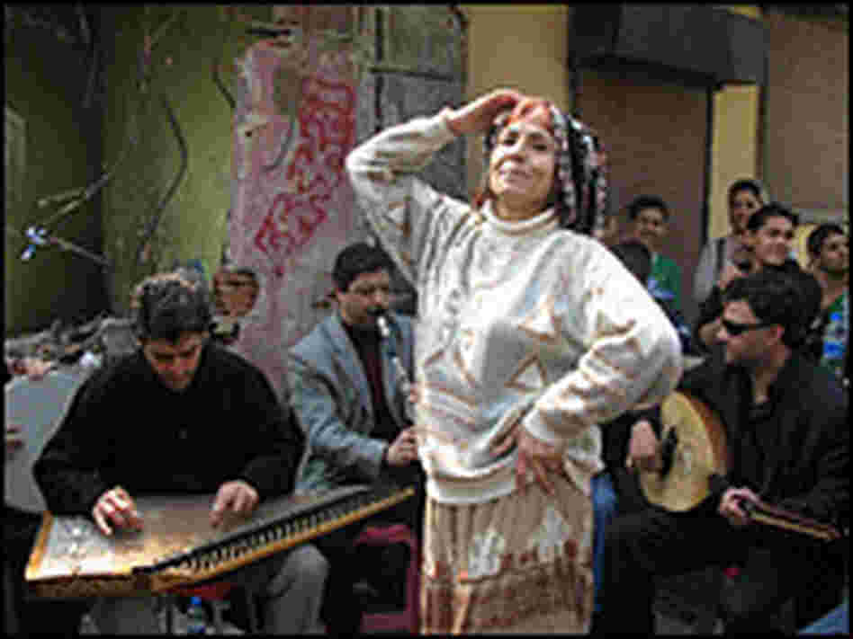 Romani musicians and a dancer. Peter Kenyon/NPR