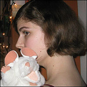 Librarian Elizabeth Bird, with a white stuffed mouse on her shoulder.