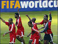 Trinidad and Tobago's players stretch as they warm up during a training session in Dortmund, Germany