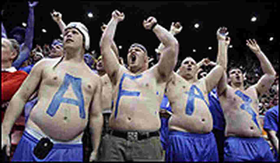 Bare-chested, big-bellied Air Force fans spell out AFA with a lightning bolt.