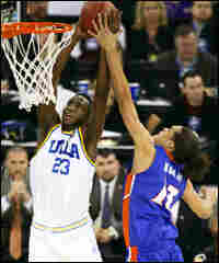 Joakim Noah of Florida blocks a UCLA shot
