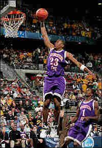 Jermaine Wallace of Northwestern State soars for a lay-in.