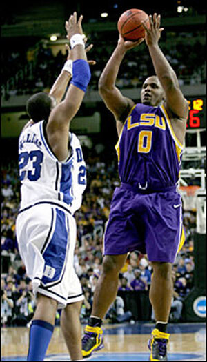 Glen Davis of LSU puts up a jump shot against Shelden Williams of Duke.