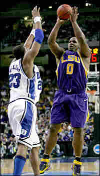 Glen Davis of LSU puts up a jump shot against Shelden Williams of Duke.