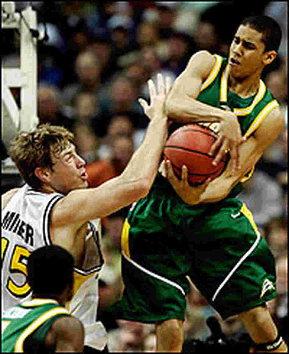 Gabe Norwood of George Mason grabs a rebound against Wichita State.