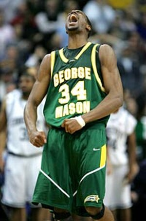 Will Thomas of George Mason exults after scoring a basket.