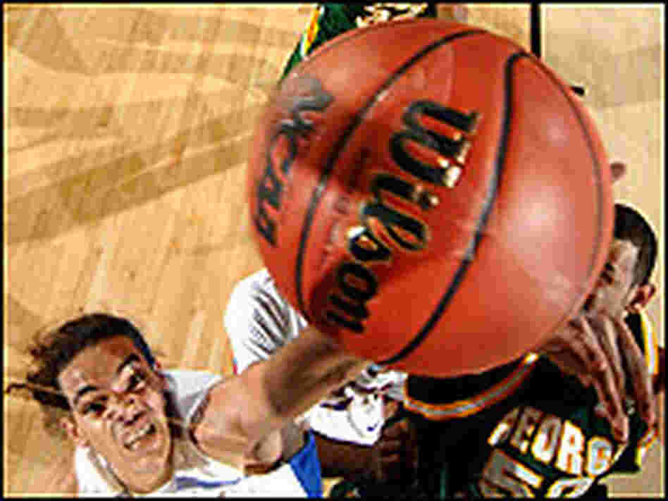 Joakim Noah of Florida reaches for a rebound as the ball comes off the rim.