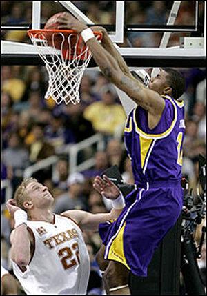 Tyrus Thomas of LSU dunks over Brad Buckman of Texas.