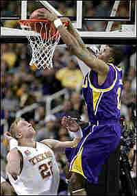 Tyrus Thomas of LSU dunks over Brad Buckman of Texas.