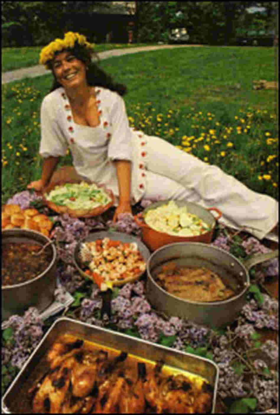 Alice Brock, pictured in 1969, with food she has made laid out before her.