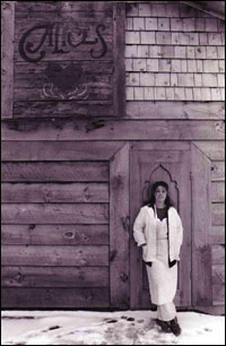 Alice Brock stands outside of her restaurant, made famous in Arlo Guthrie's 1967 song.