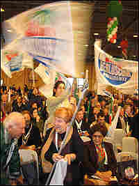 A Berlusconi supporter waves a huge flag.
