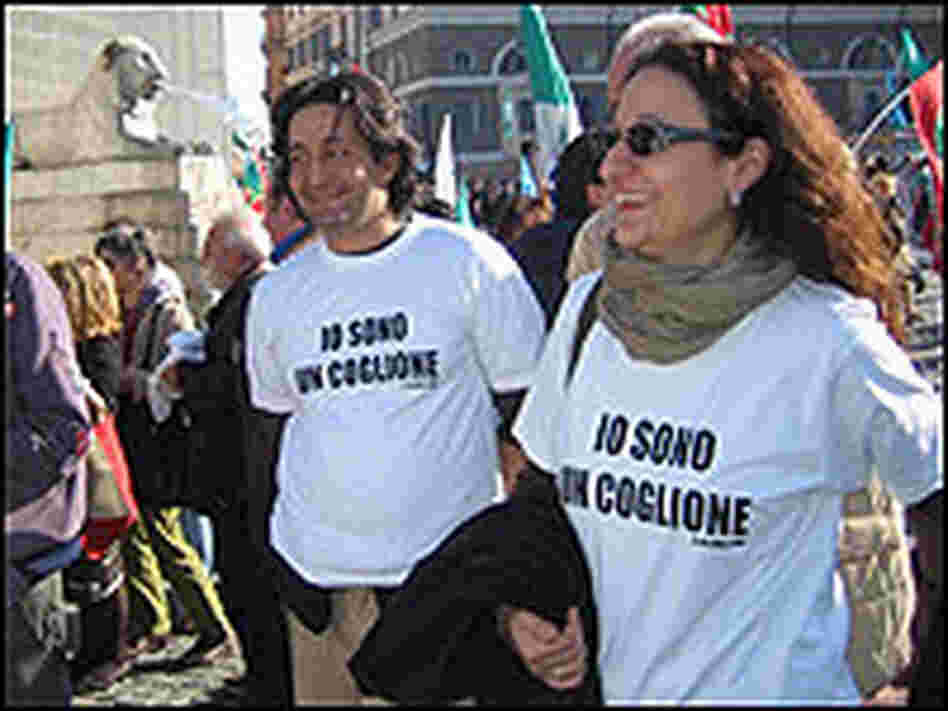 Prodi supporters wear T-shirts that say 'I'm a Moron.'